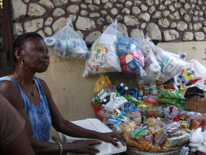 Woman given support by Oxfam Livelihoods project to restock her business after losing everything, including her home, in the earthquake
