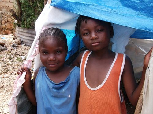 Kids working with Oxfam in Haiti.